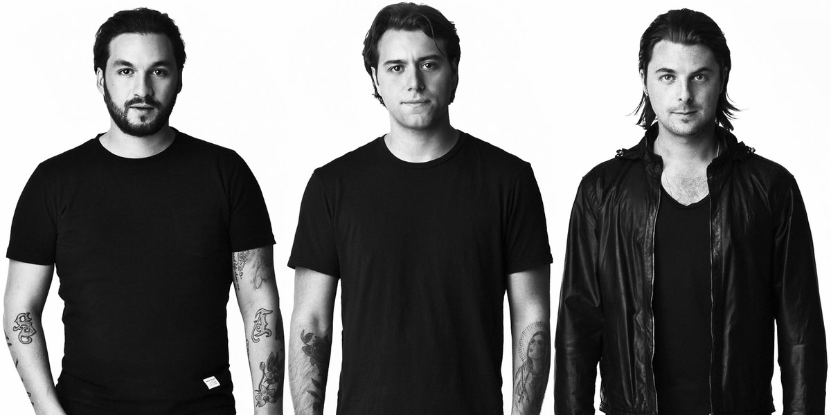 Black and white photo of Swedish House Mafia members Steve Angello, Sebastian Ingrosso and Axwell.