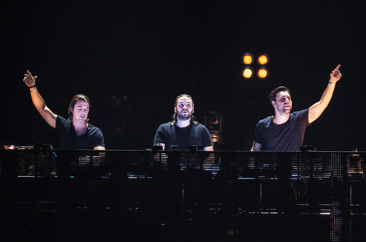 Swedish EDM trio Swedish House Mafia during a DJ performance.