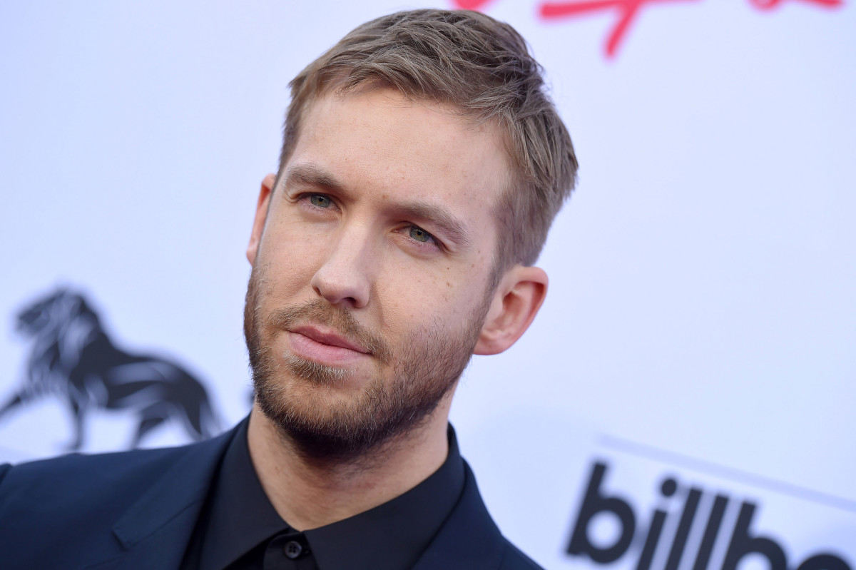 Photo of Scottish DJ/producer Calvin Harris in front of a splash with Billboard's logo on it.