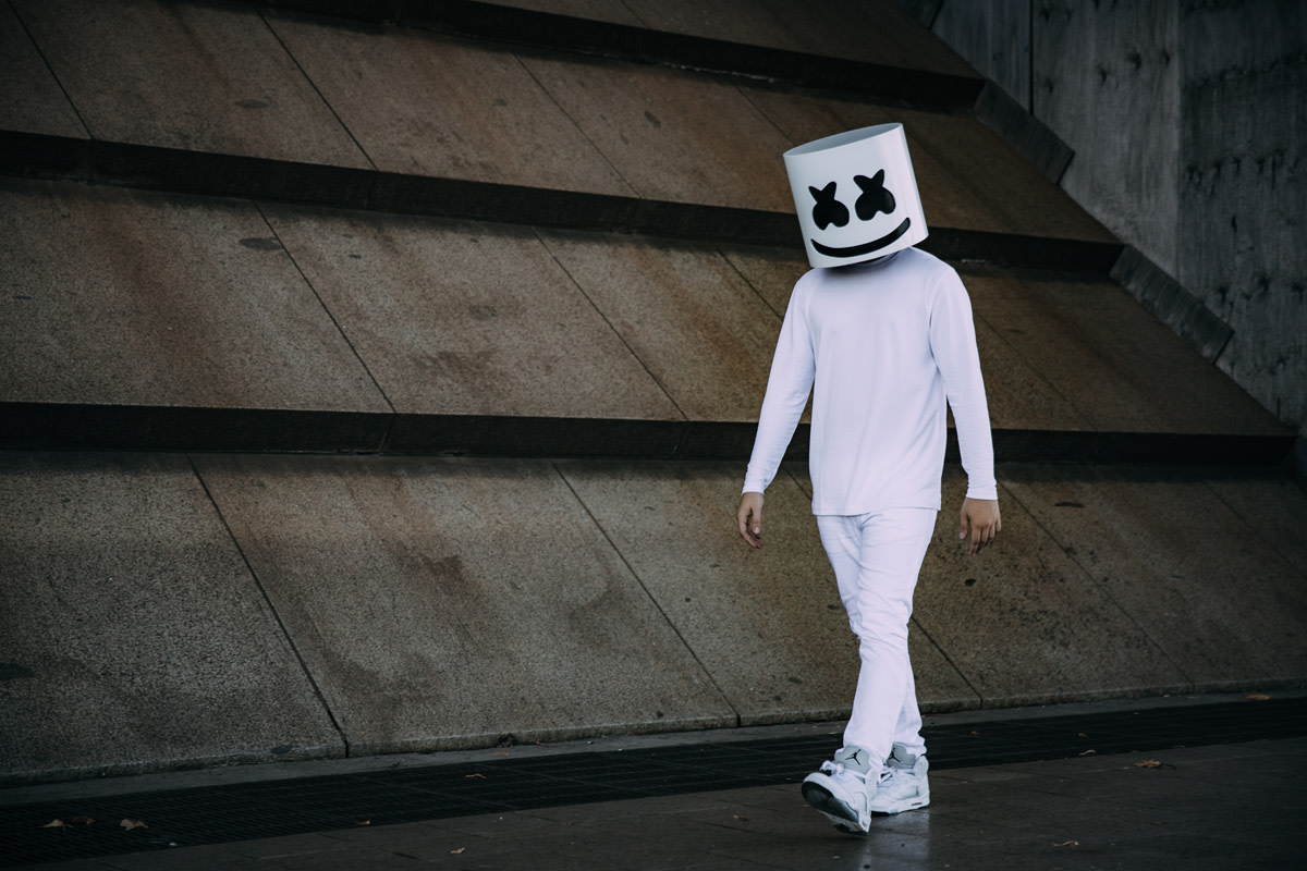 Photo of anonymous DJ/producer Marshmello walking.