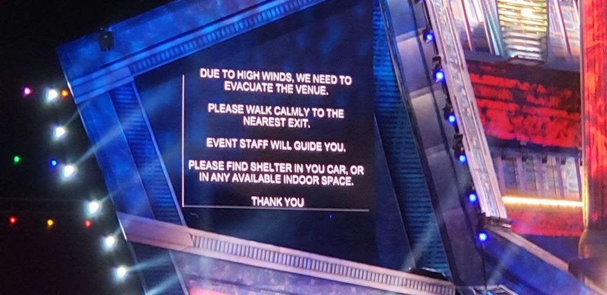 EDC Las Vegas evacuation message displayed on one of the stages' screens in 2019.