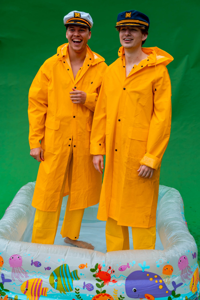 Ship Wrek In Yellow Rain Jackets Standing In Baby Pool (Press Photo)