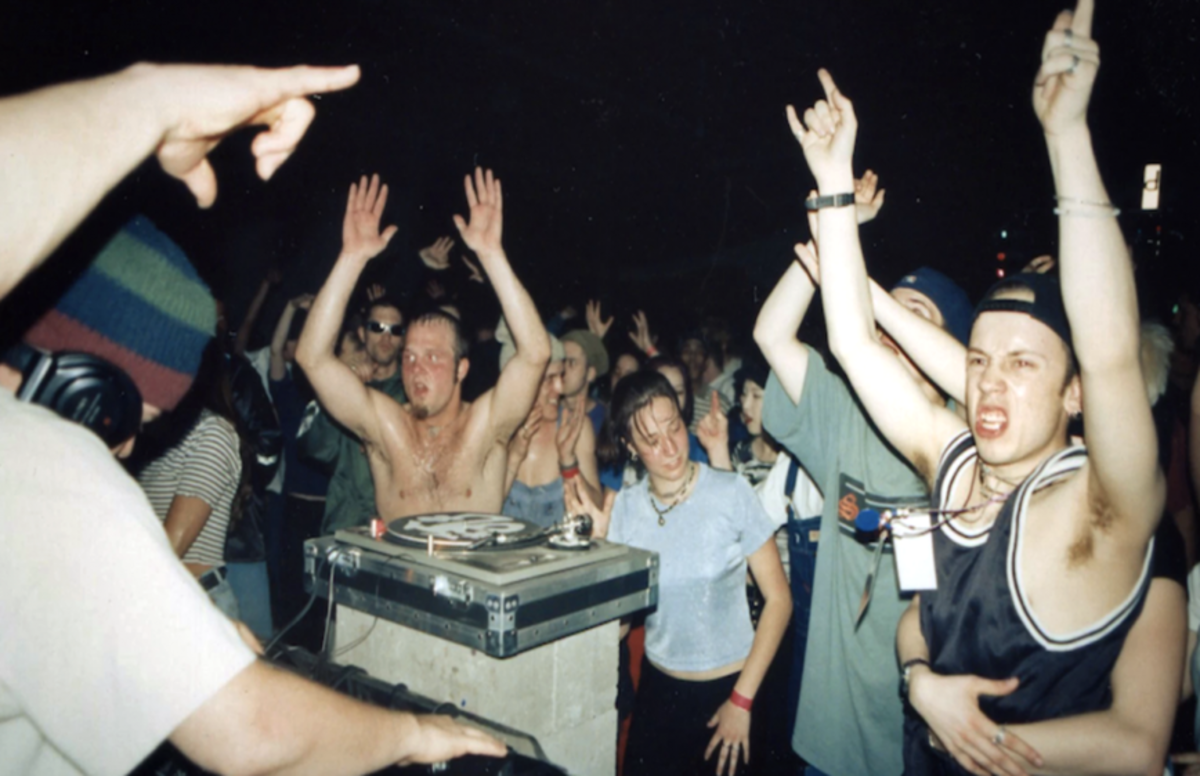 Australian ravers in the early 1990s getting hype and shuffling to their favorite underground DJs.