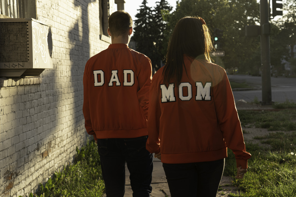 Mom N Dad - Press Photo From Behind w/ Lens Flare (MOM and DAD Red Jackets)