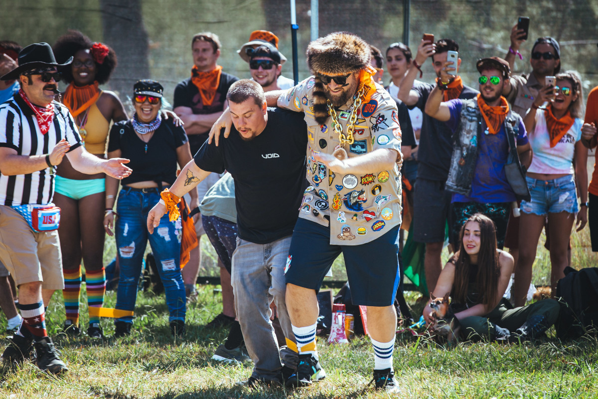 A camper gets cheered on by his campmates in the three-legged race with Claude VonStroke.