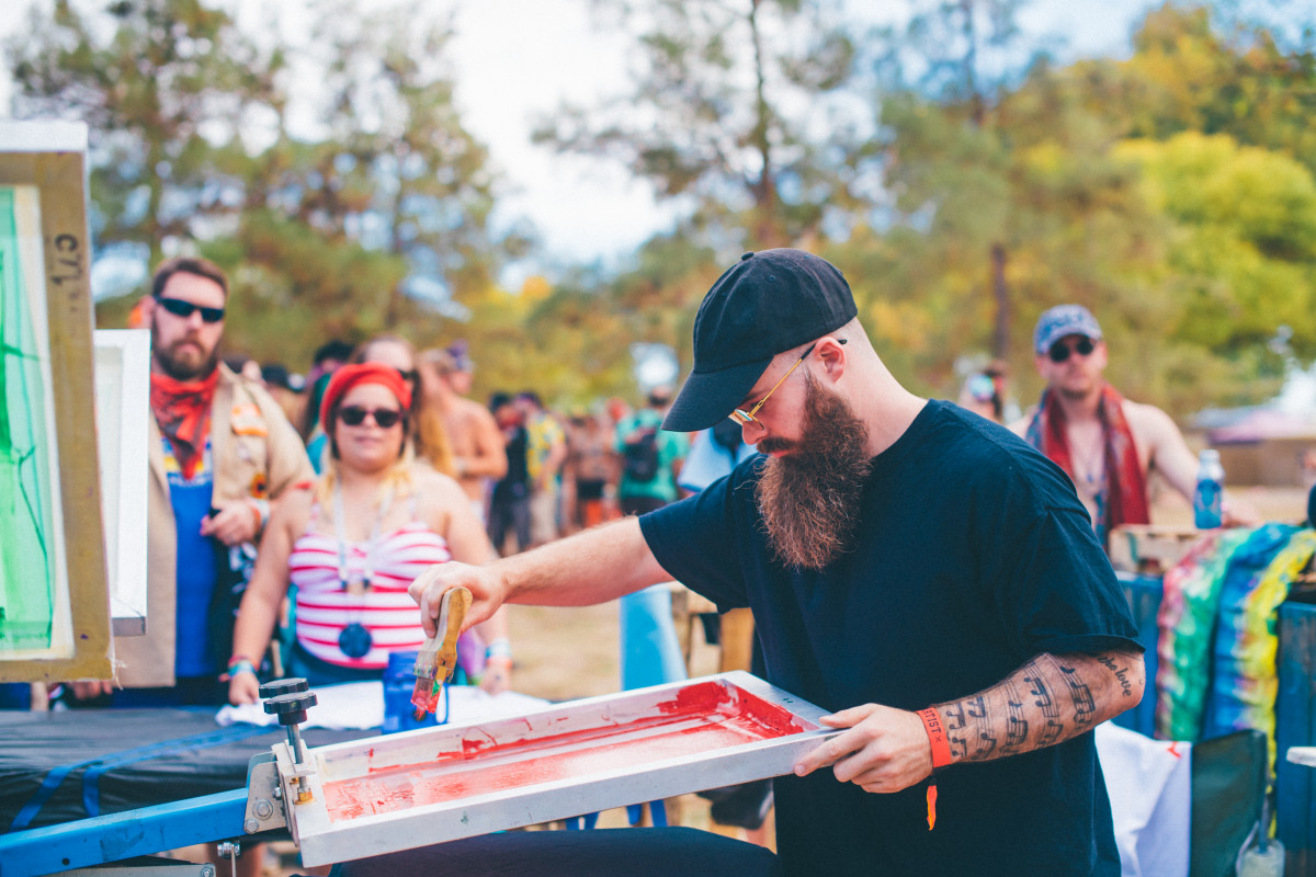 Will Clarke screen-prints a shirt with fans at Dirtybird Campout.