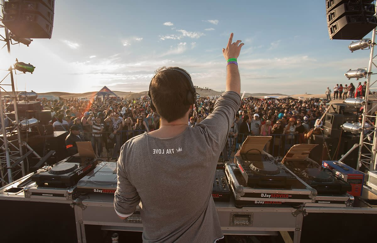 behind a dj in the desert
