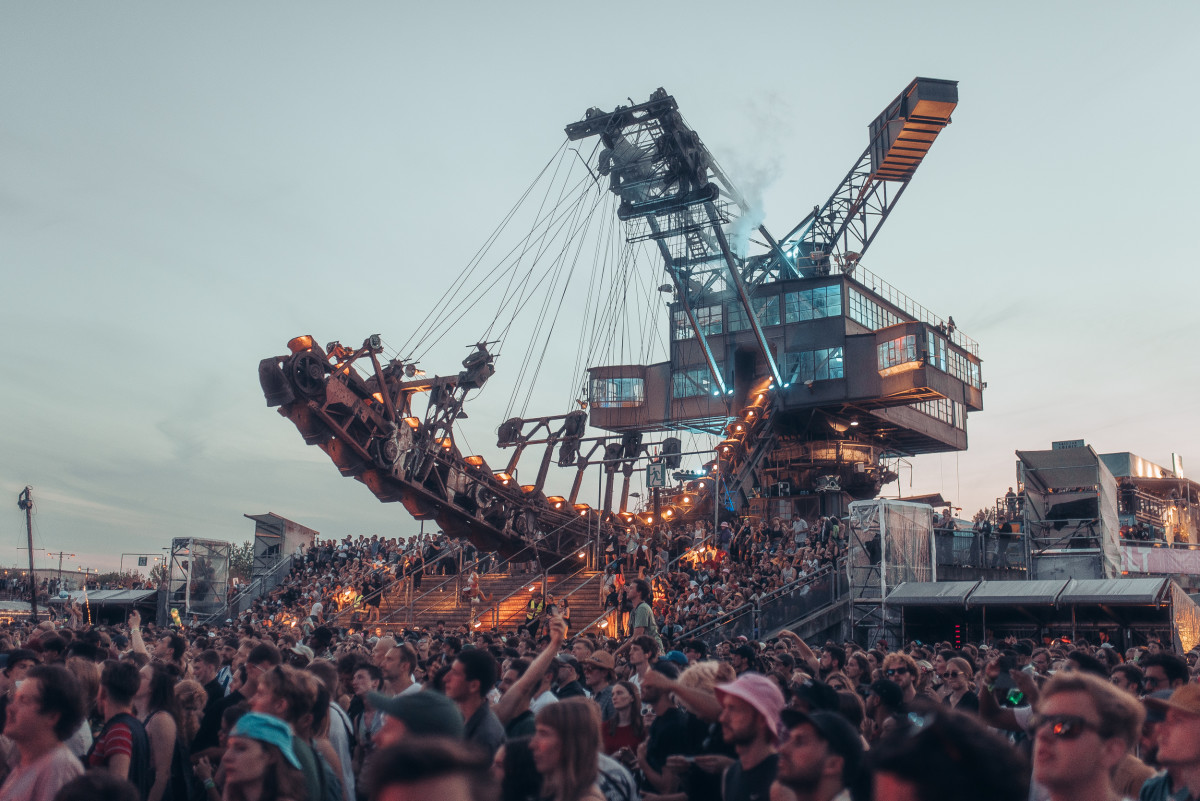 excavator in a crowd