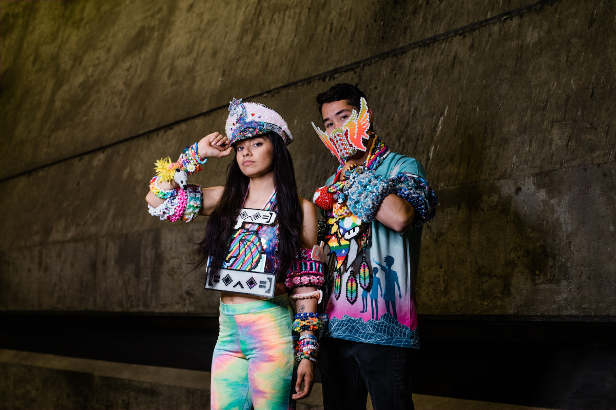 two people standing with kandi