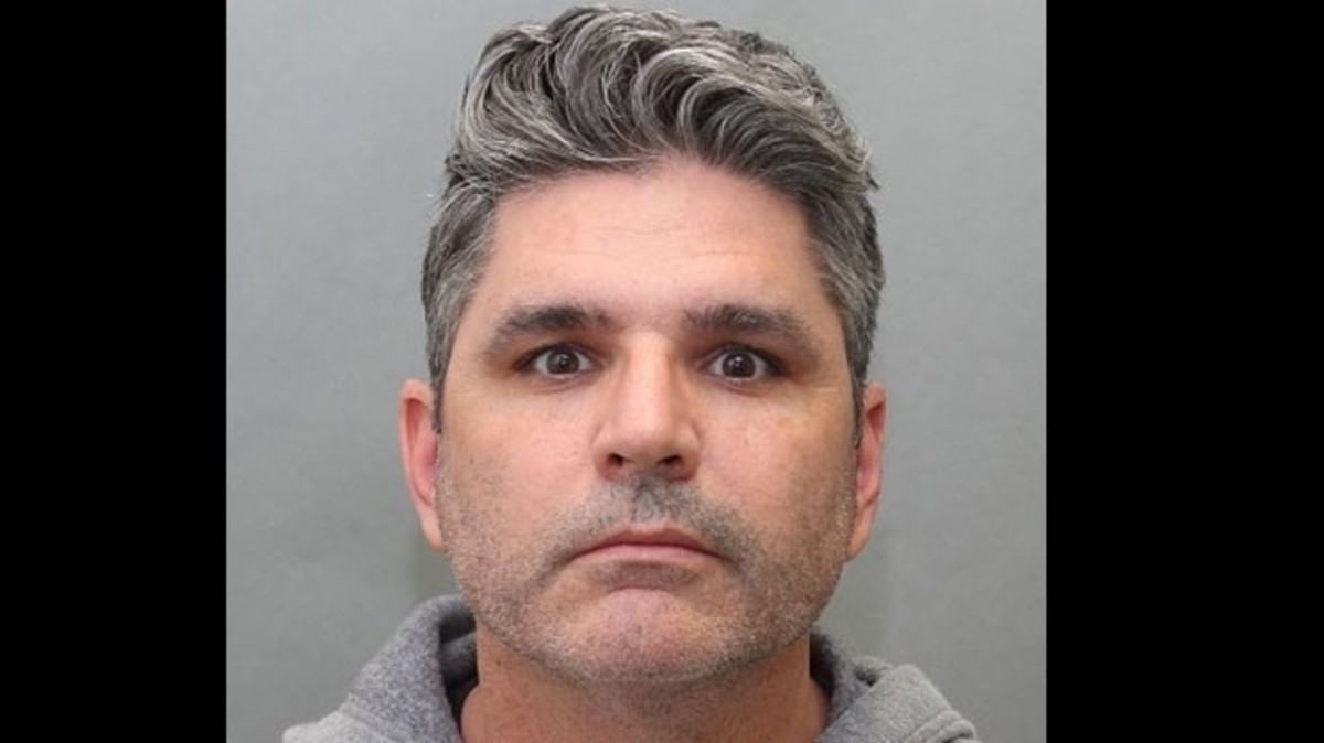 A mugshot of 43-year-old Christopher Pulleyn via Toronto Police Service.