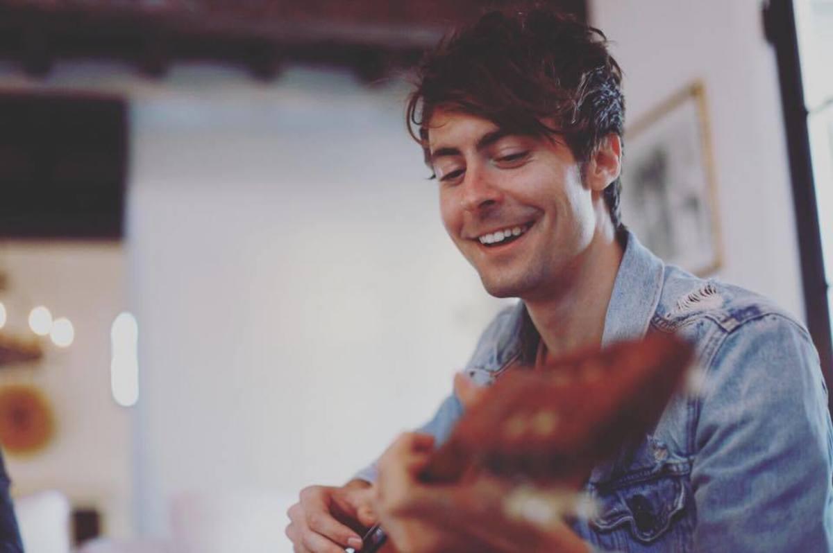 DallasK playing guitar