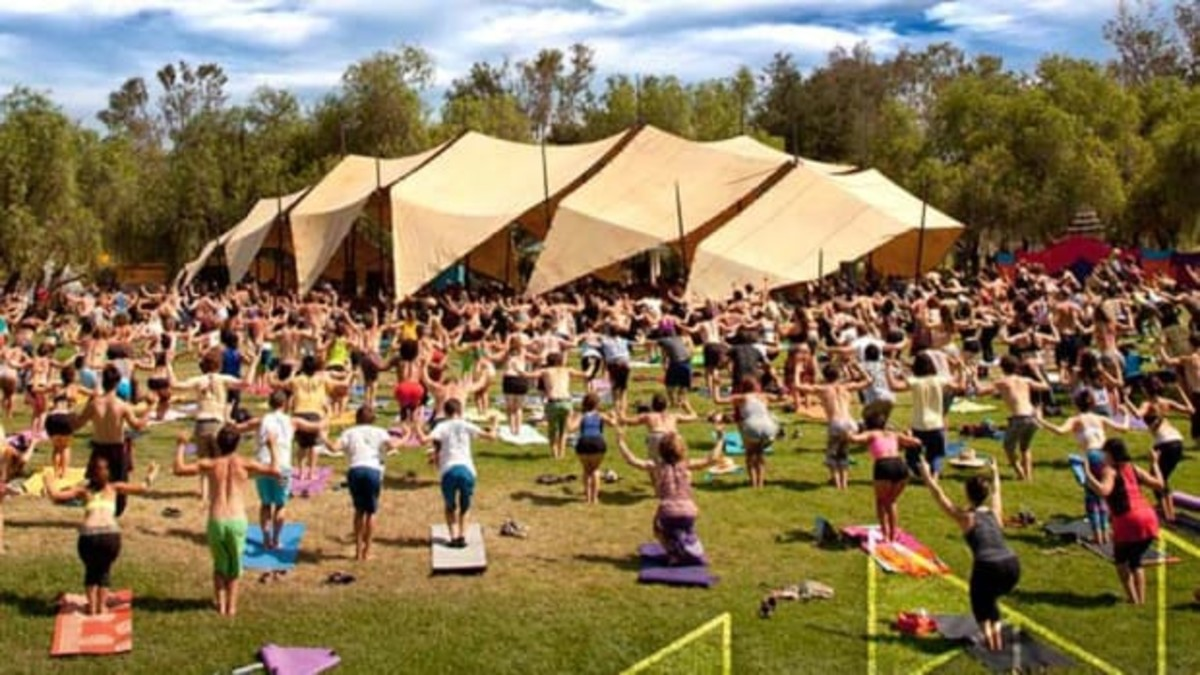 Attendees of Lightning in a Bottle participate in daily festival yoga to stretch out for the day.