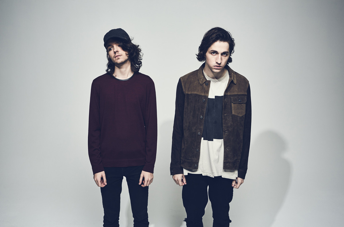 A press photo of DJ/producers Porter Robinson and Madeon.