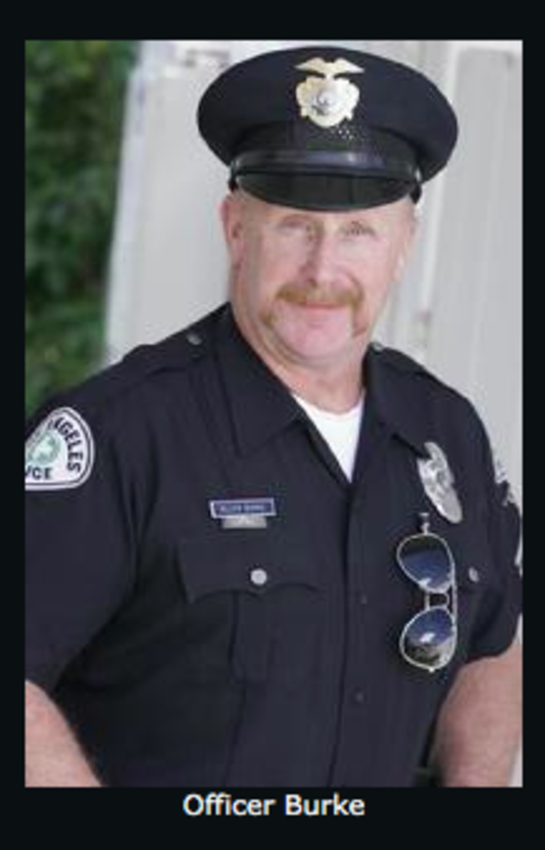 A photo of police officer character Officer Burke as it appears on talent/rental website Cop Shop L.A.