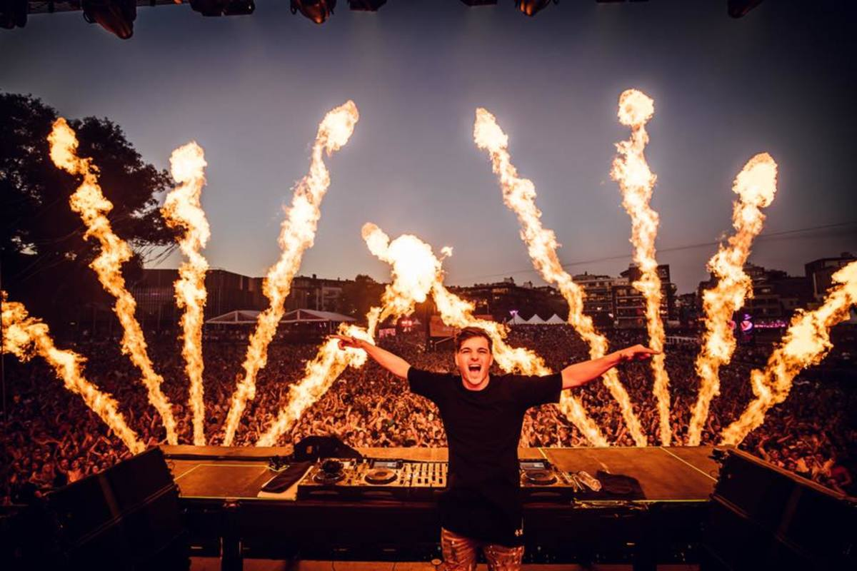 Martin Garrix stage shot with pyrotechnics.