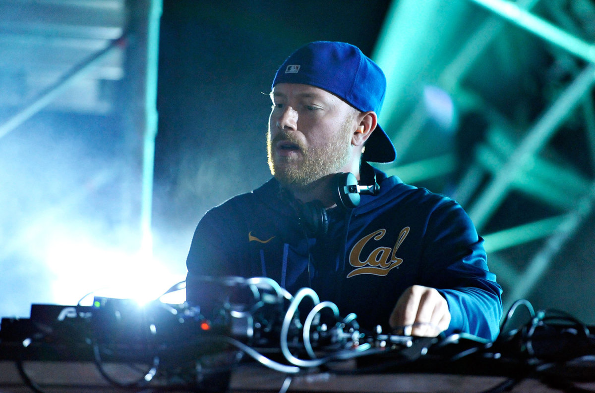 A color photo of Swedish DJ/producer Eric Prydz during a performance wearing blue over a blue background.