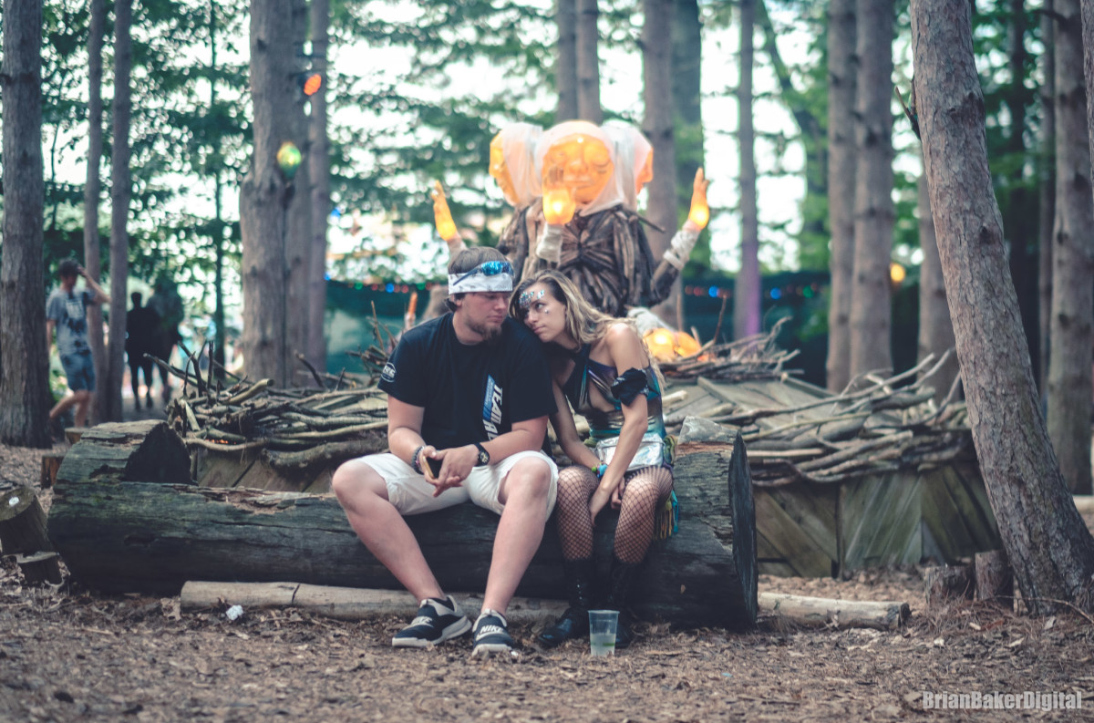 couple sitting at electric forest