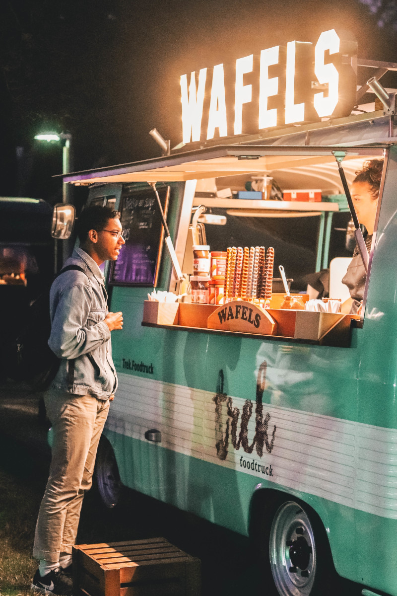 man in front of a waffle food truck