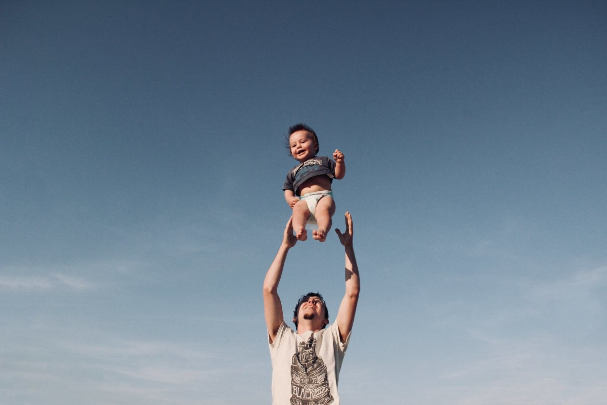 baby thrown in the air