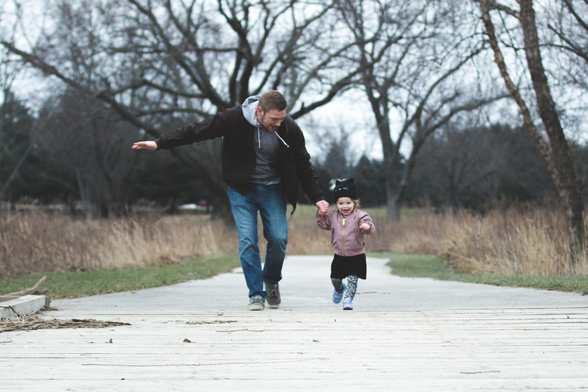 girl and dad running