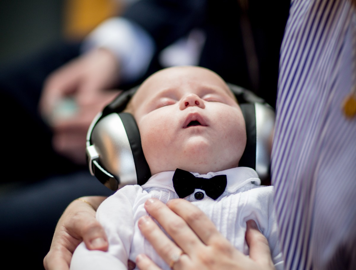 baby with bowtie and headphones