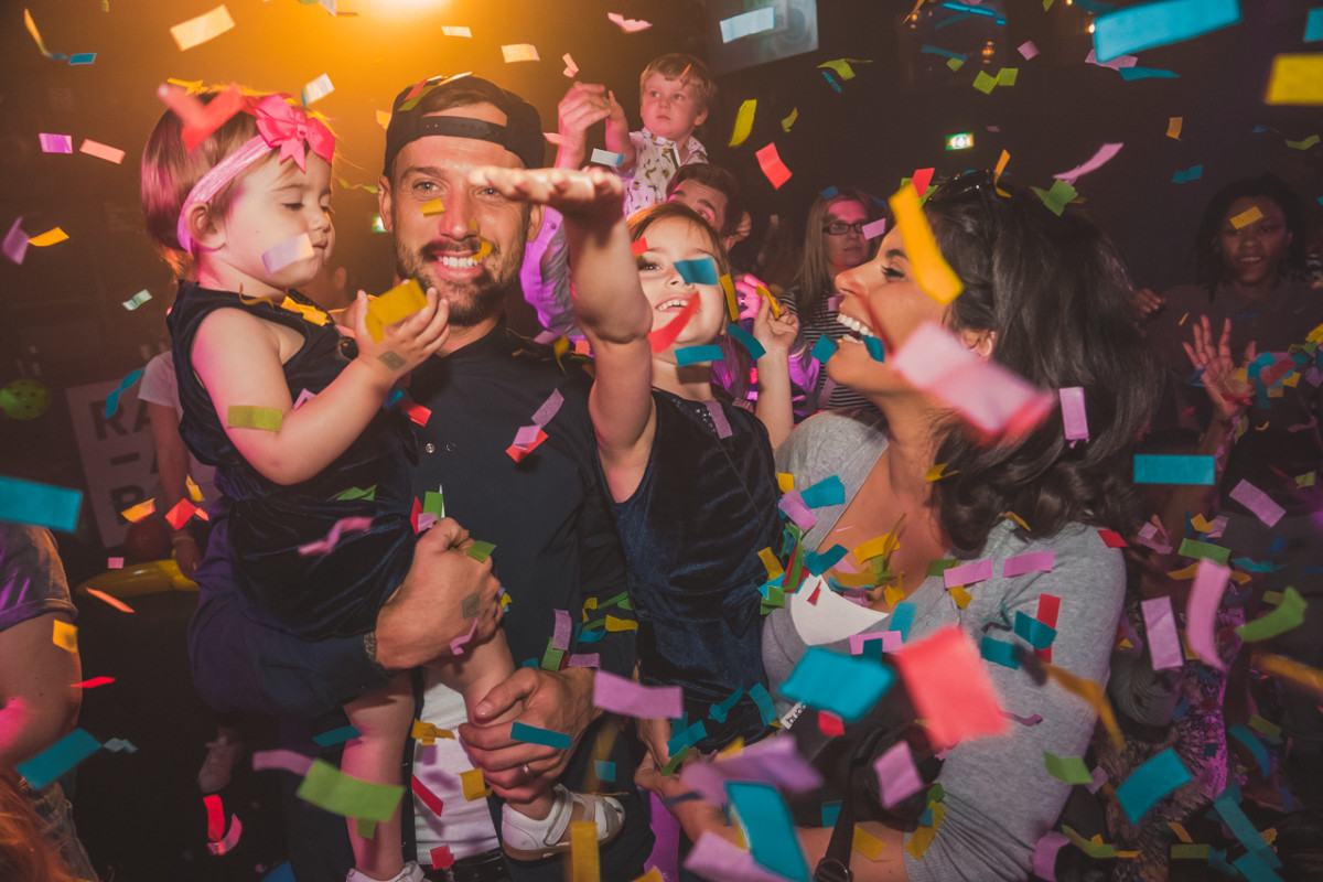 family and babies under confetti