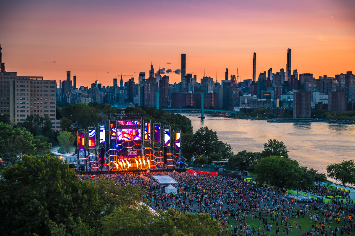 The sun setting against the New York skyline at Electric Zoo