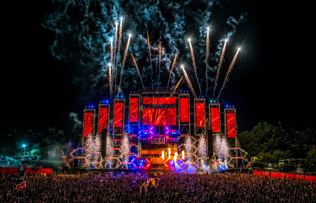 Fireworks erupt over the main stage at Electric Zoo
