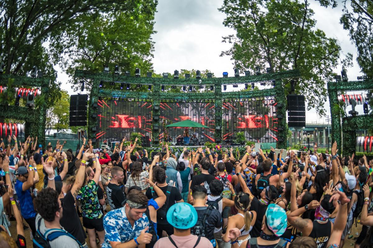 A crowd enjoying a set at The Den