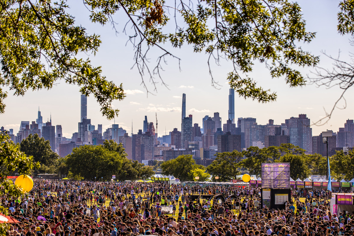 A striking juxtaposition of the crowd at Electric Zoo against the New York skyline