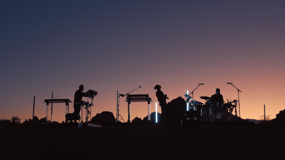 RÜFÜS DU SOL performing in Joshua Tree National Park.