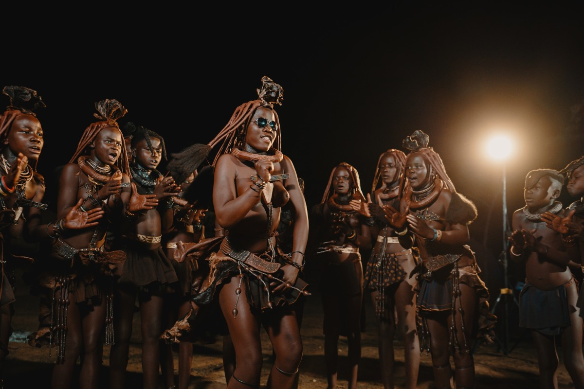 Members of the Himba tribe dance to electronic music during filming of The Ive Experience.