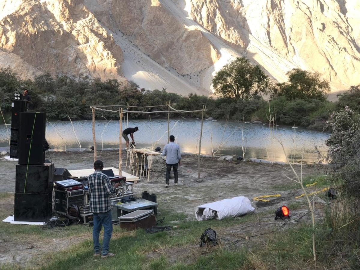 Organizers setting up a stage at Hunza Verse music festival