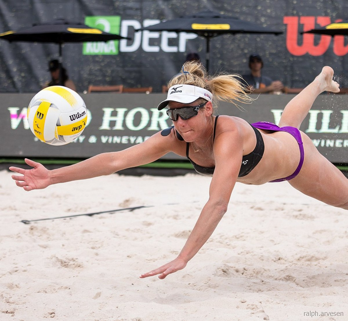 April Ross diving for a ball at the AVP Austin Open professional beach volleyball tournament in Austin, Texas on May 19th, 2017.