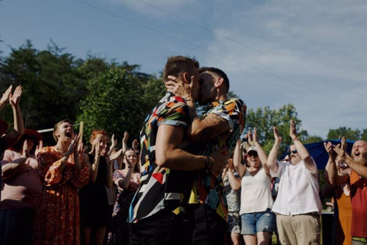 Jamon Deaver and Joey Lawton embrace at Wonder Woods.