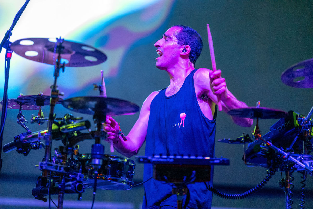 Cofresi live drumming onstage during his set on the Illumination Stage.