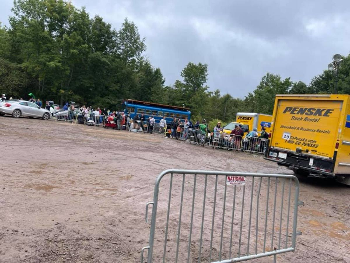 Prospective attendees wait to be transported to the campgrounds of Elements Music & Arts Festival.